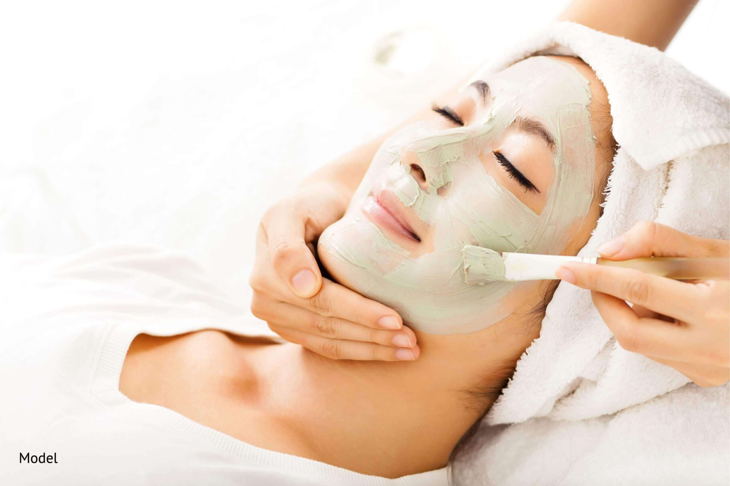 Asian woman being pampered by facial