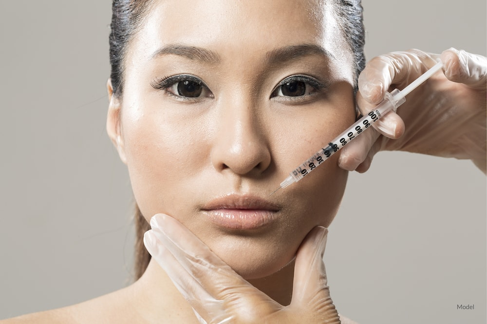 Asian woman undergoing BOTOX® Cosmetic injections.
